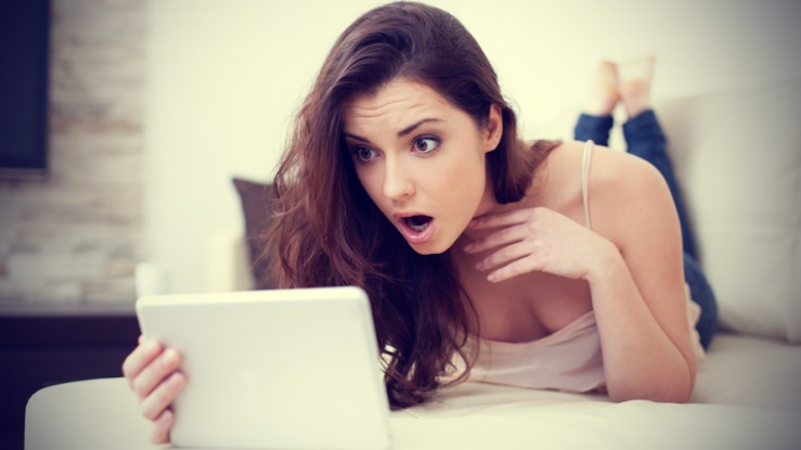 woman-working-on-her-computer-with-a-shocked-expression-on-her-face
